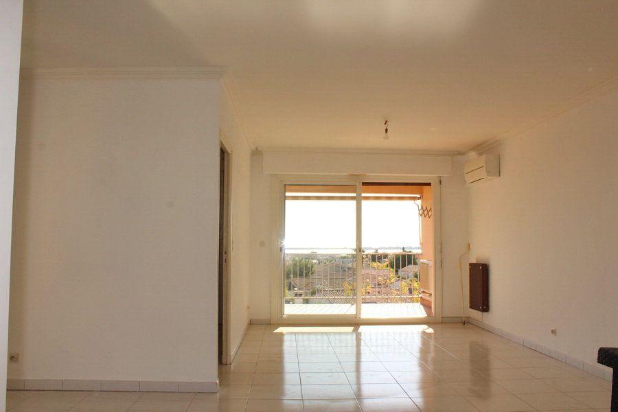 Appartement à vendre 3 69m2 à Marseillan vignette-3