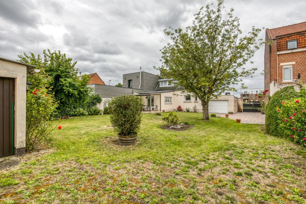 Maison à vendre 4 107.65m2 à Tourcoing vignette-5