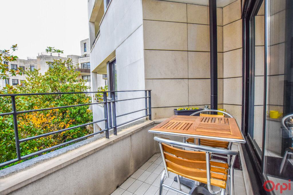 Appartement à louer 2 72m2 à Paris 15 vignette-9