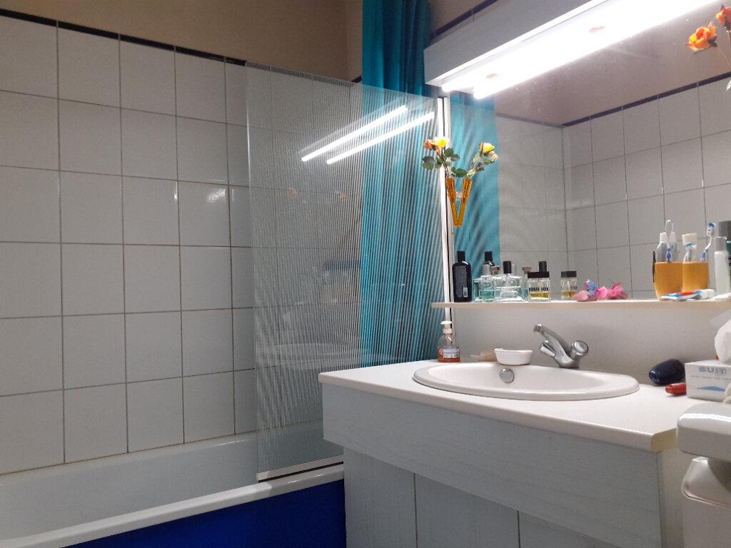 Appartement à vendre 2 59.22m2 à Reims vignette-4