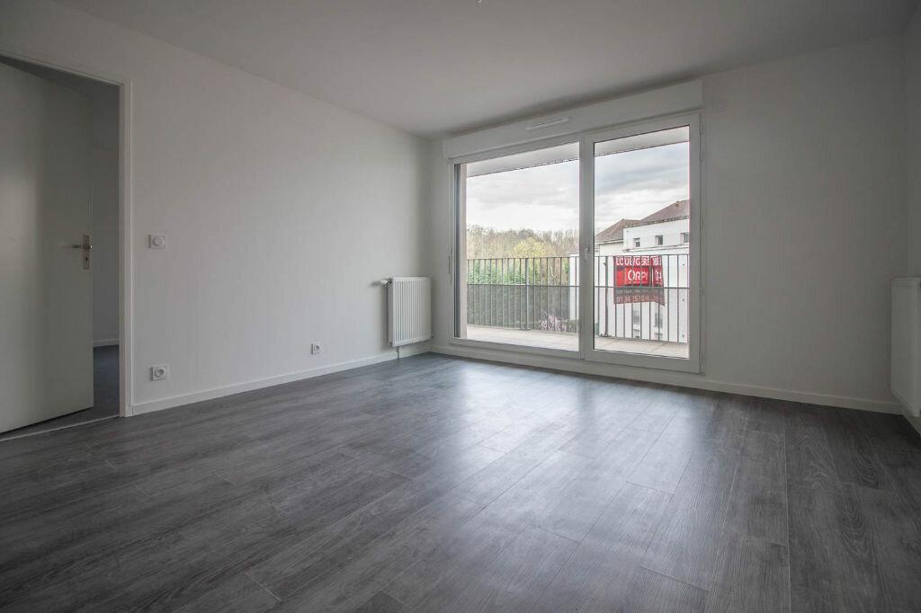 Appartement à louer 2 40.55m2 à Osny vignette-1