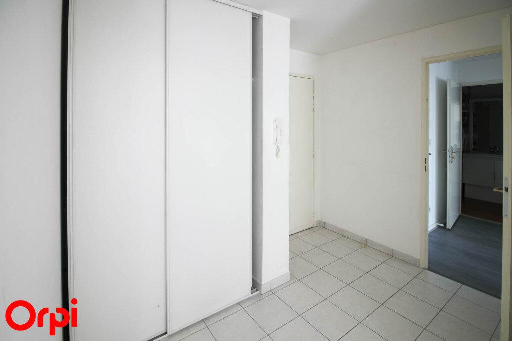 Appartement à louer 3 61.71m2 à Osny vignette-2