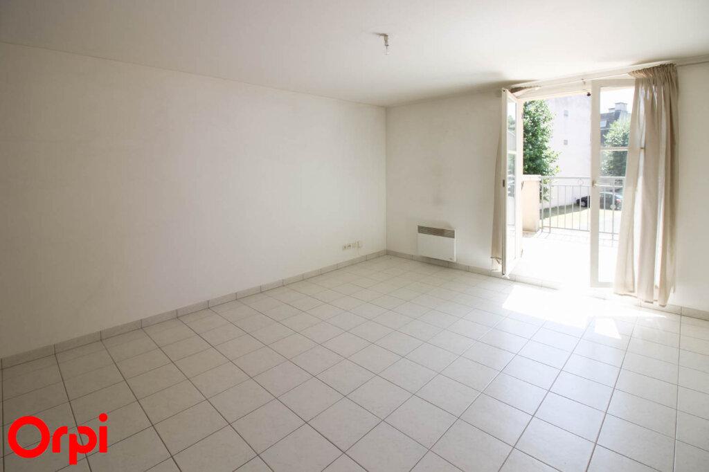 Appartement à louer 3 61.71m2 à Osny vignette-4