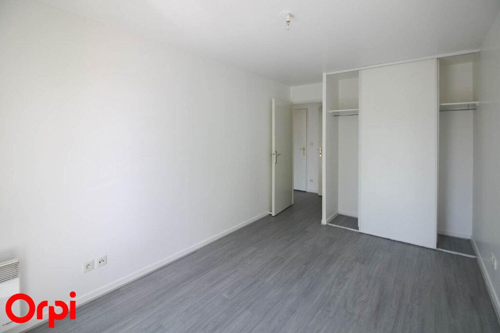 Appartement à louer 3 61.71m2 à Osny vignette-7