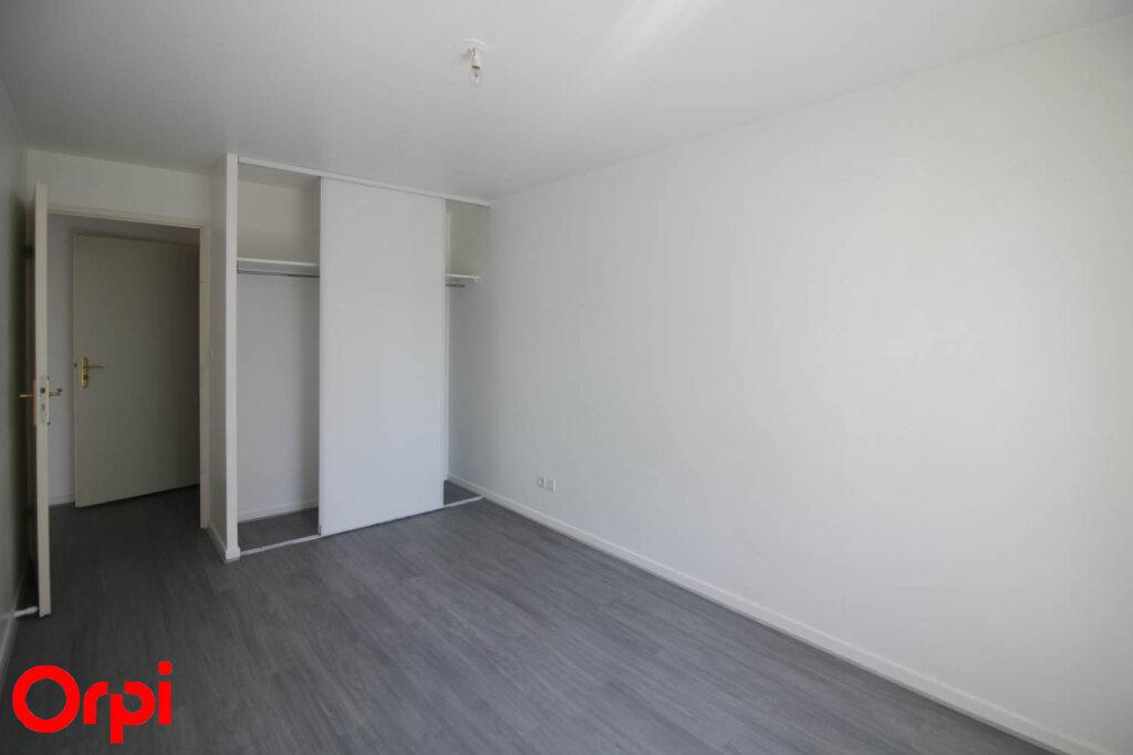 Appartement à louer 3 61.71m2 à Osny vignette-9