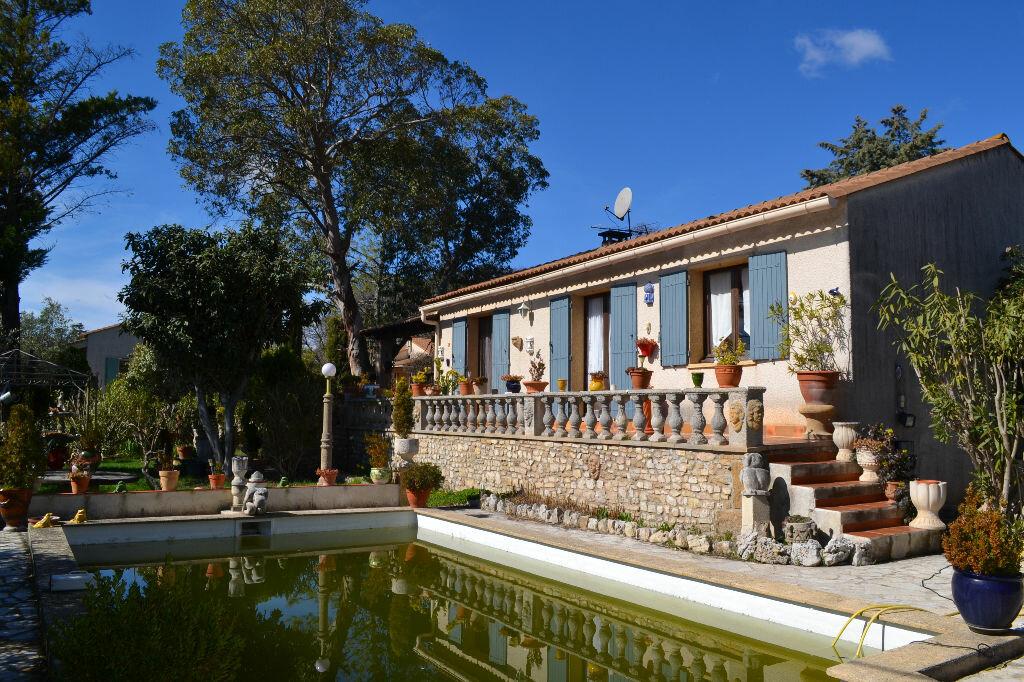 Maison à vendre 5 115m2 à Arpaillargues-et-Aureillac vignette-5