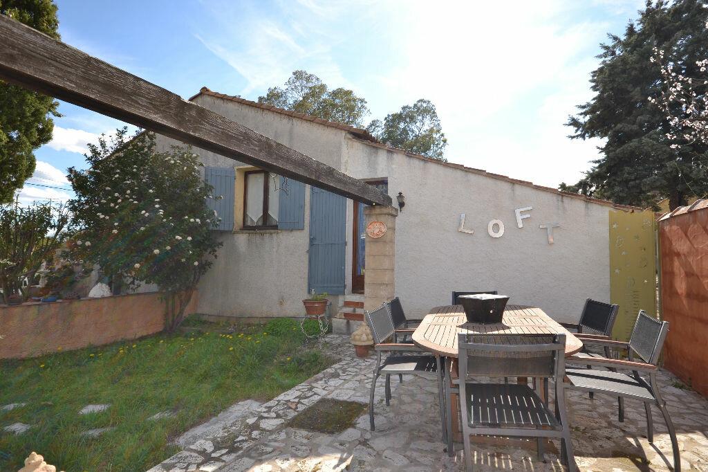 Maison à vendre 5 115m2 à Arpaillargues-et-Aureillac vignette-9
