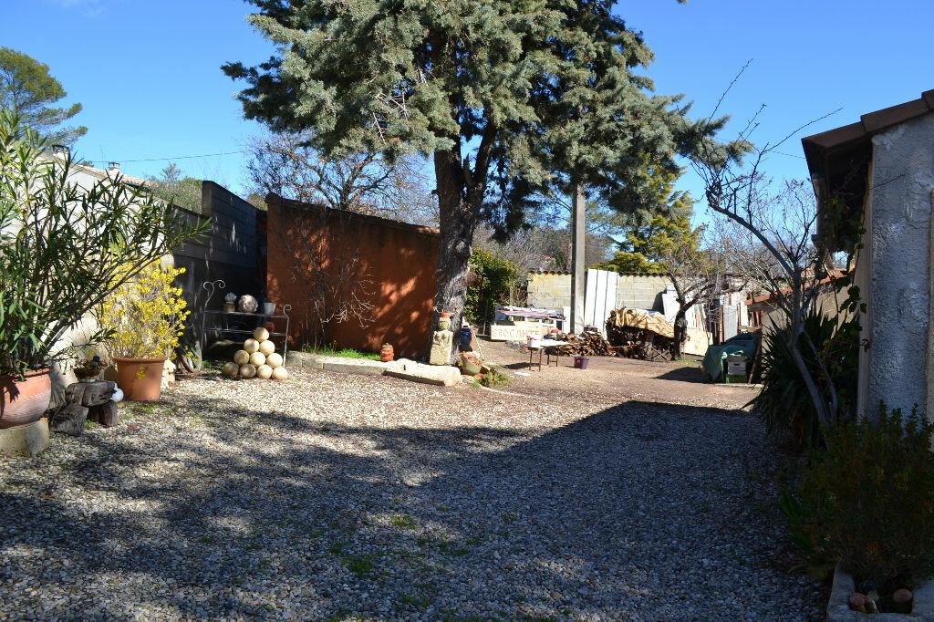 Maison à vendre 5 115m2 à Arpaillargues-et-Aureillac vignette-10