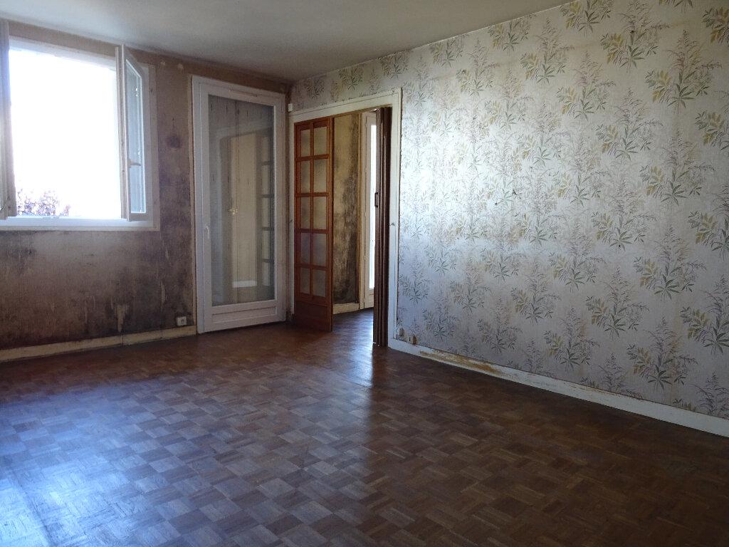 Appartement à vendre 4 70.59m2 à Notre-Dame-de-Sanilhac vignette-2