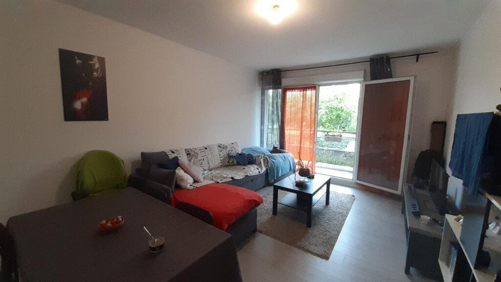 Appartement à louer 3 61.57m2 à Élancourt vignette-2