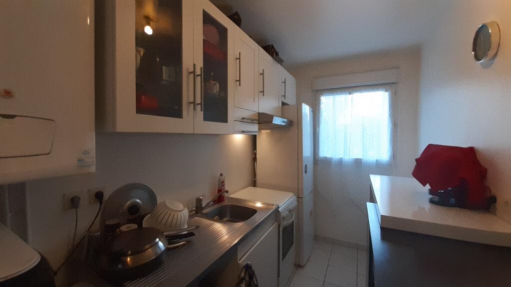 Appartement à louer 3 61.57m2 à Élancourt vignette-3