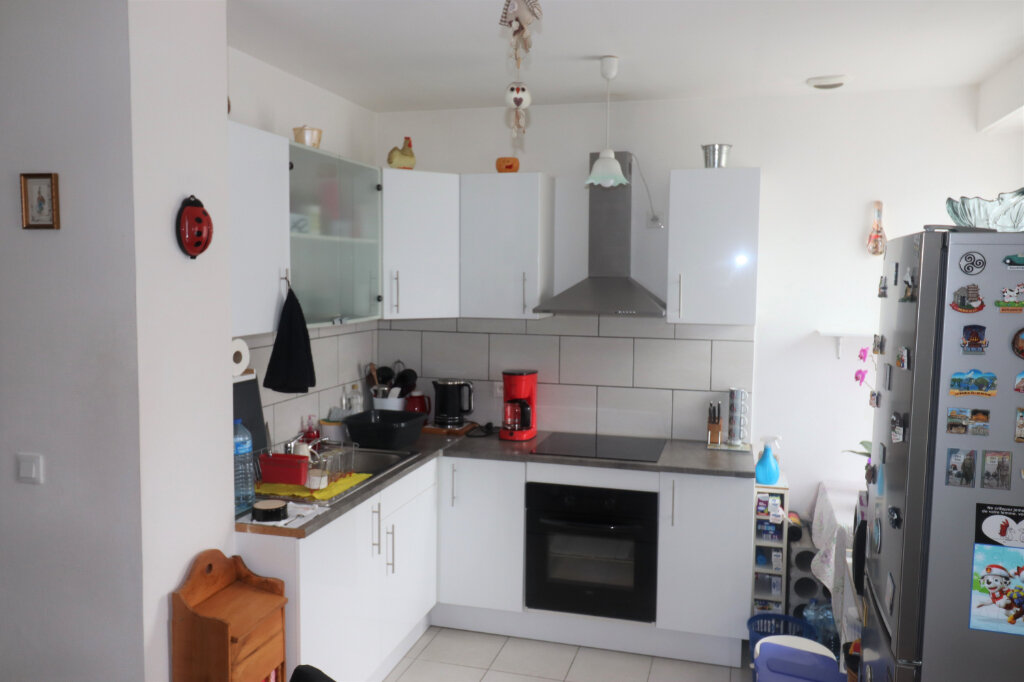 Appartement à vendre 2 58m2 à Schiltigheim vignette-3