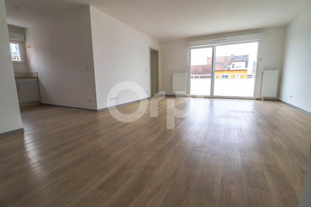 Appartement à louer 4 89m2 à Horbourg-Wihr vignette-1