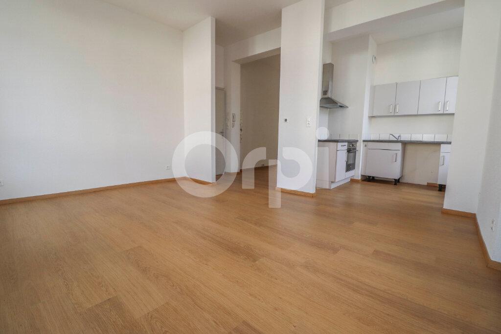 Appartement à louer 2 49.66m2 à Horbourg-Wihr vignette-1