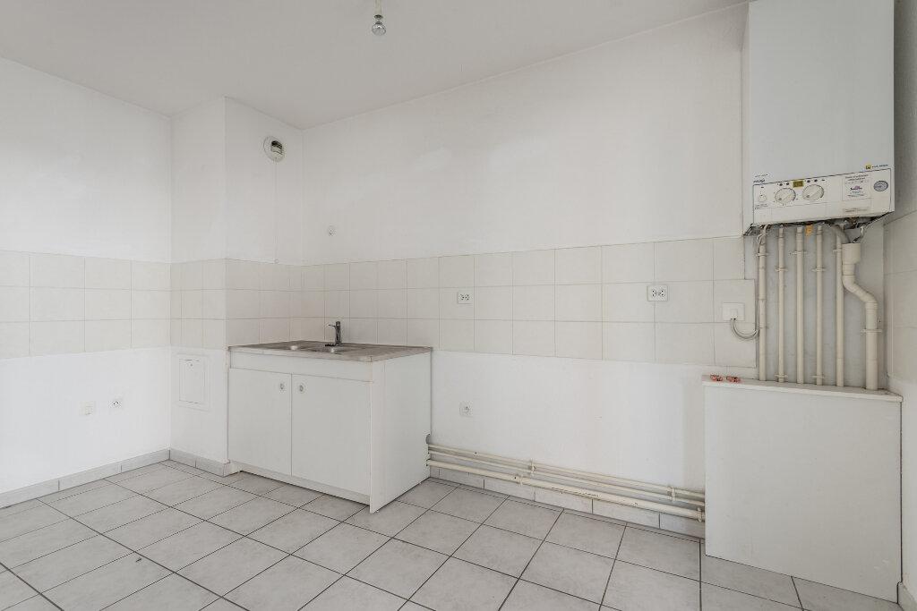 Appartement à vendre 3 67.61m2 à Erstein vignette-4