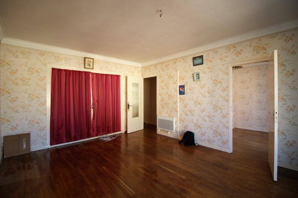 Appartement à vendre 4 58m2 à Carhaix-Plouguer vignette-1