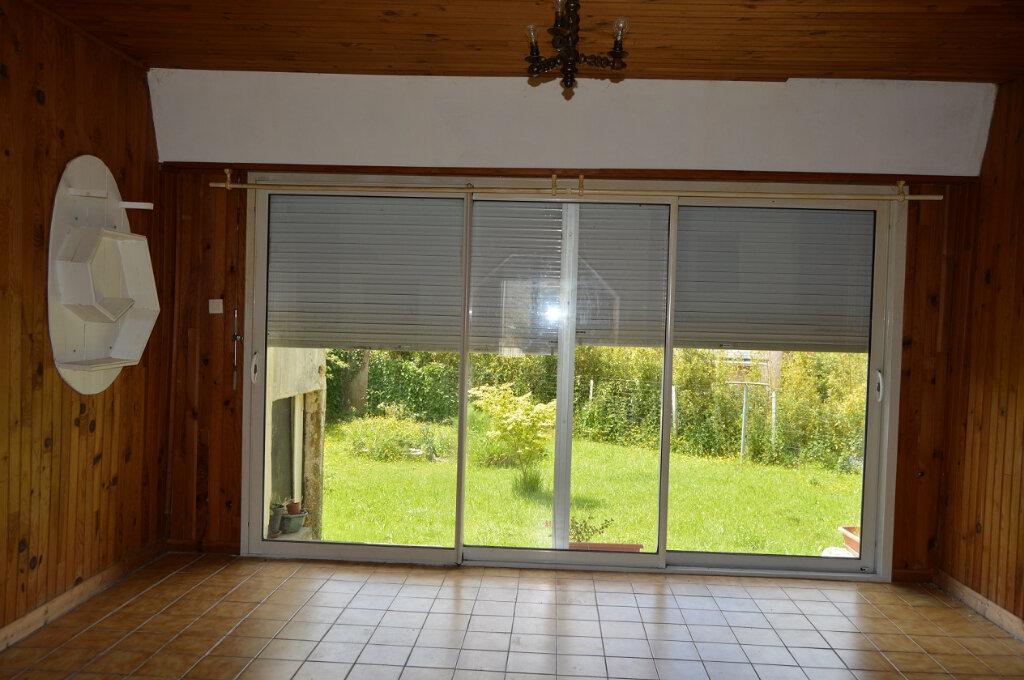 Maison à vendre 7 111.57m2 à Rostrenen vignette-4