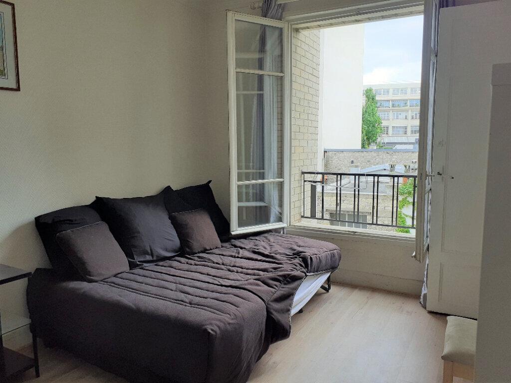 Appartement à louer 1 24.59m2 à Paris 15 vignette-5
