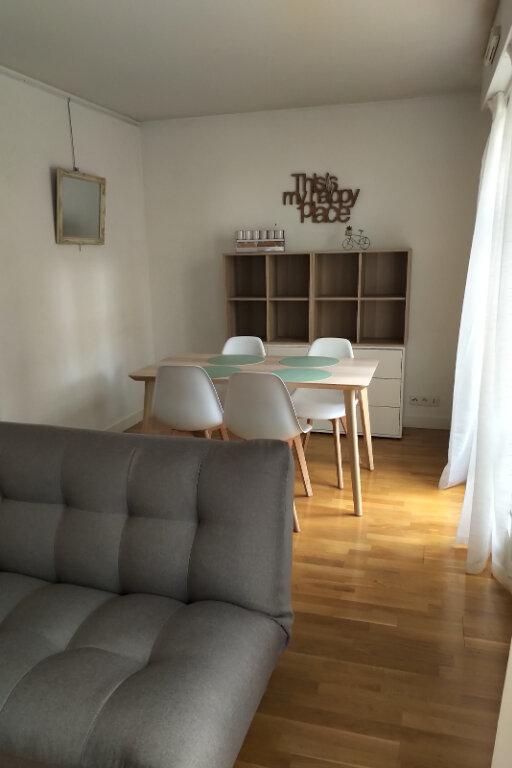 Appartement à louer 3 59m2 à Paris 15 vignette-1