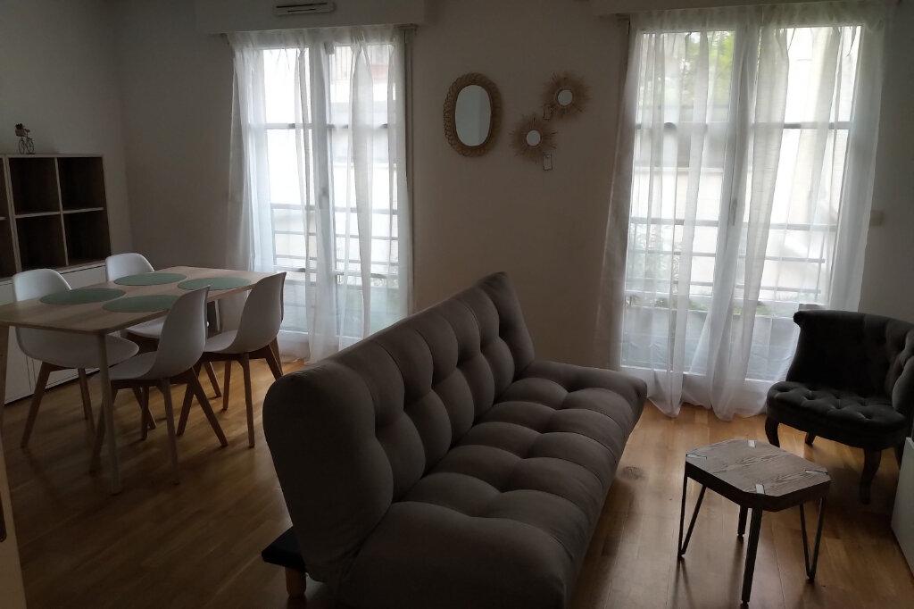 Appartement à louer 3 59m2 à Paris 15 vignette-3