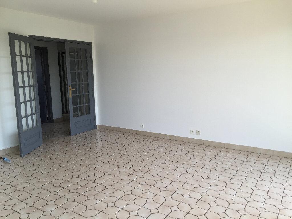 Appartement à louer 3 62.51m2 à Houilles vignette-3