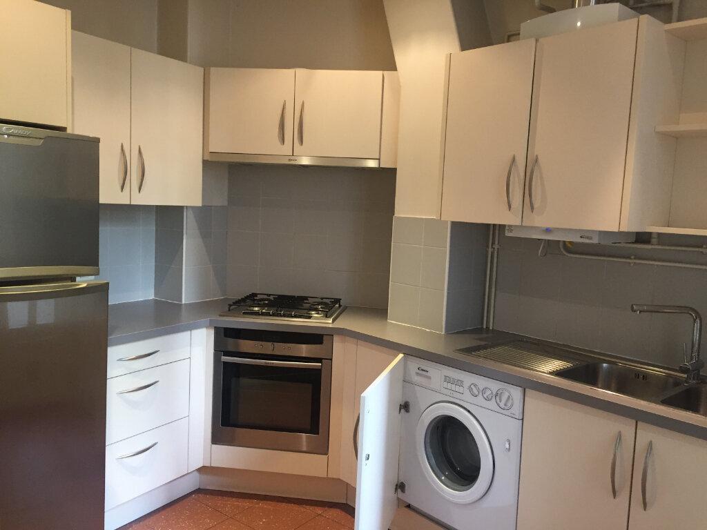 Appartement à louer 2 41.85m2 à Paris 17 vignette-1