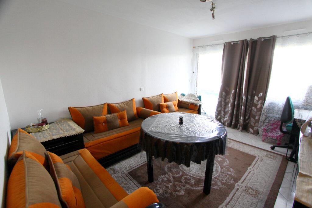 Appartement à vendre 3 60.02m2 à Les Mureaux vignette-1