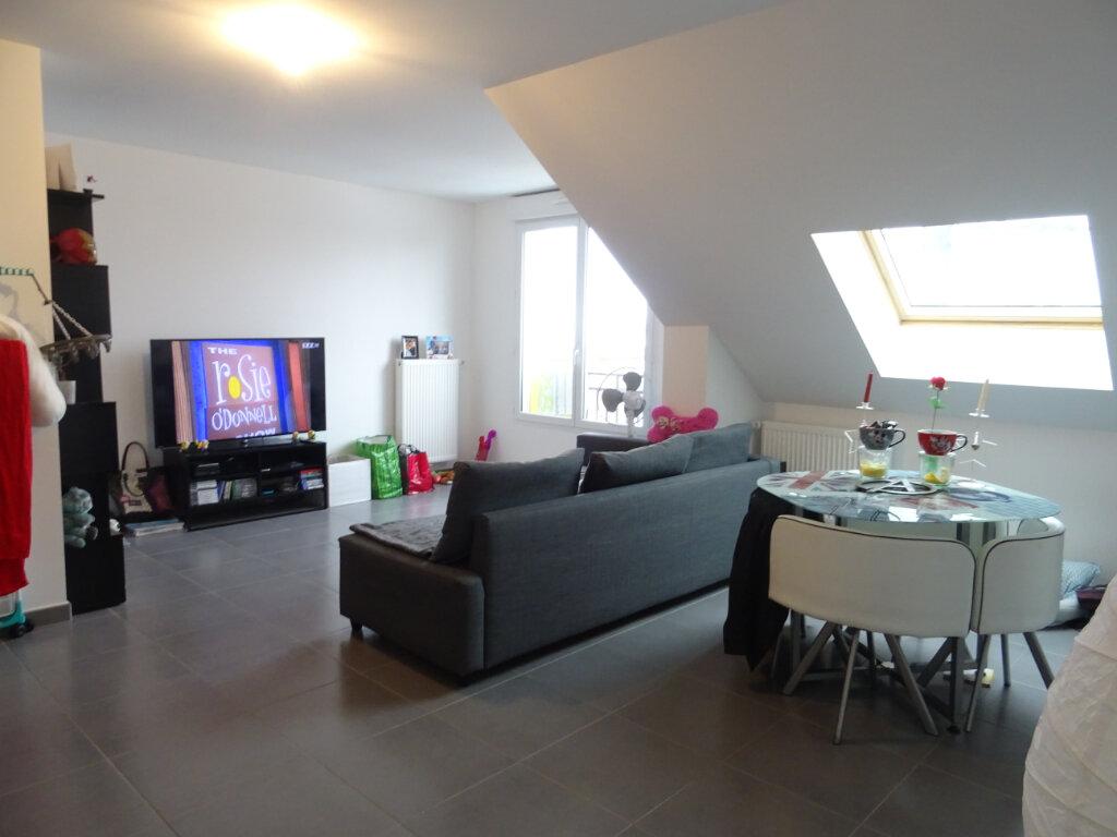 Appartement à louer 2 53.35m2 à Neufmoutiers-en-Brie vignette-1