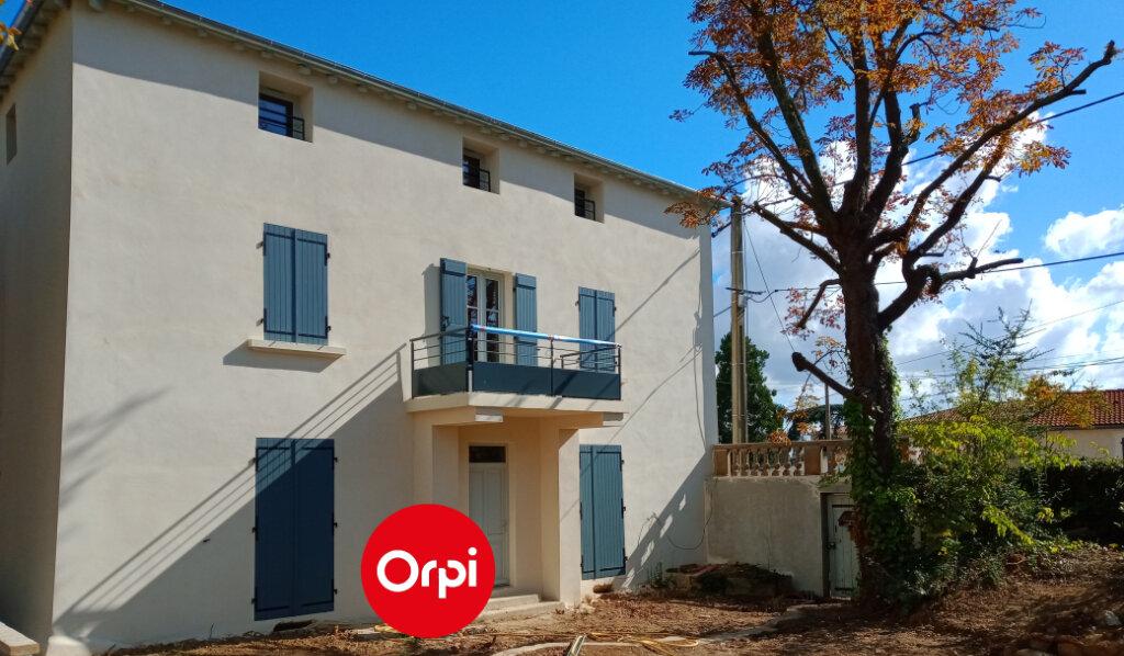 Appartement à vendre 5 112m2 à Saint-Genis-Laval vignette-1