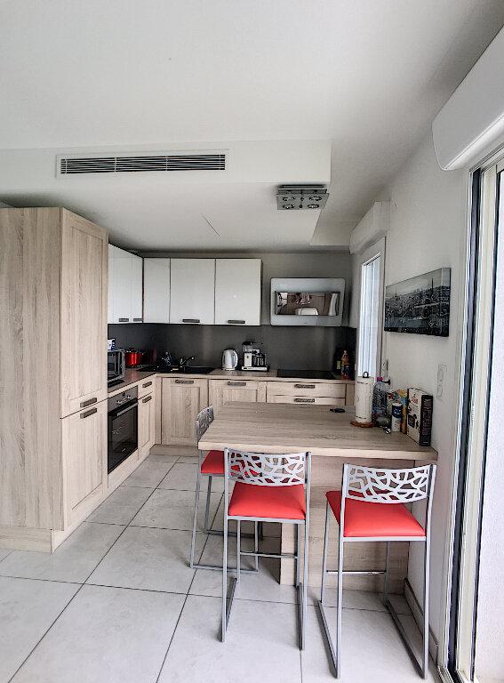 Appartement à vendre 3 77m2 à Saint-Laurent-du-Var vignette-2