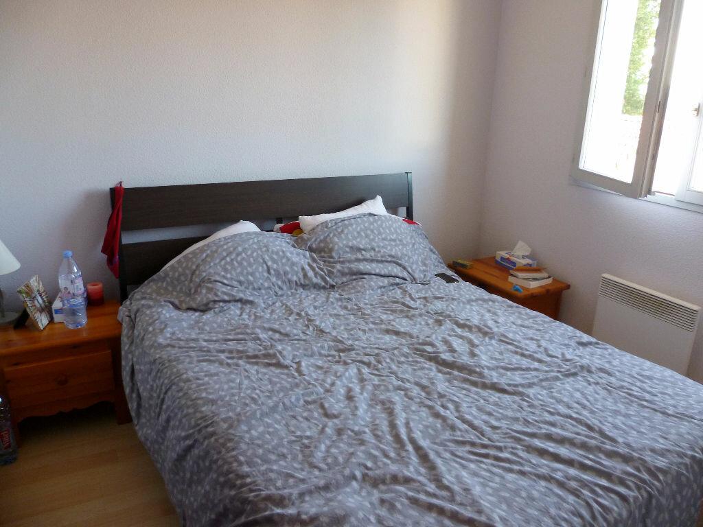 Appartement à louer 3 59.68m2 à Saint-Étienne-de-Saint-Geoirs vignette-4