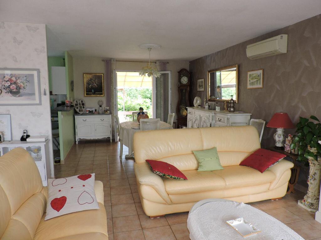 Maison à vendre 3 81m2 à Saint-Julien-les-Rosiers vignette-4