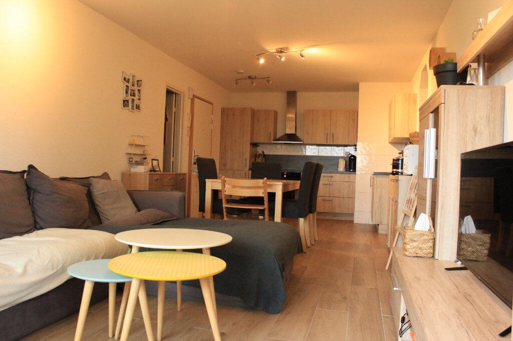 Appartement à vendre 4 76.6m2 à Saint-Genis-Pouilly vignette-3