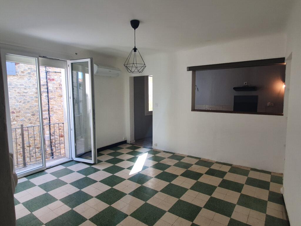 Appartement à louer 3 56m2 à Saint-Julien-de-Peyrolas vignette-3