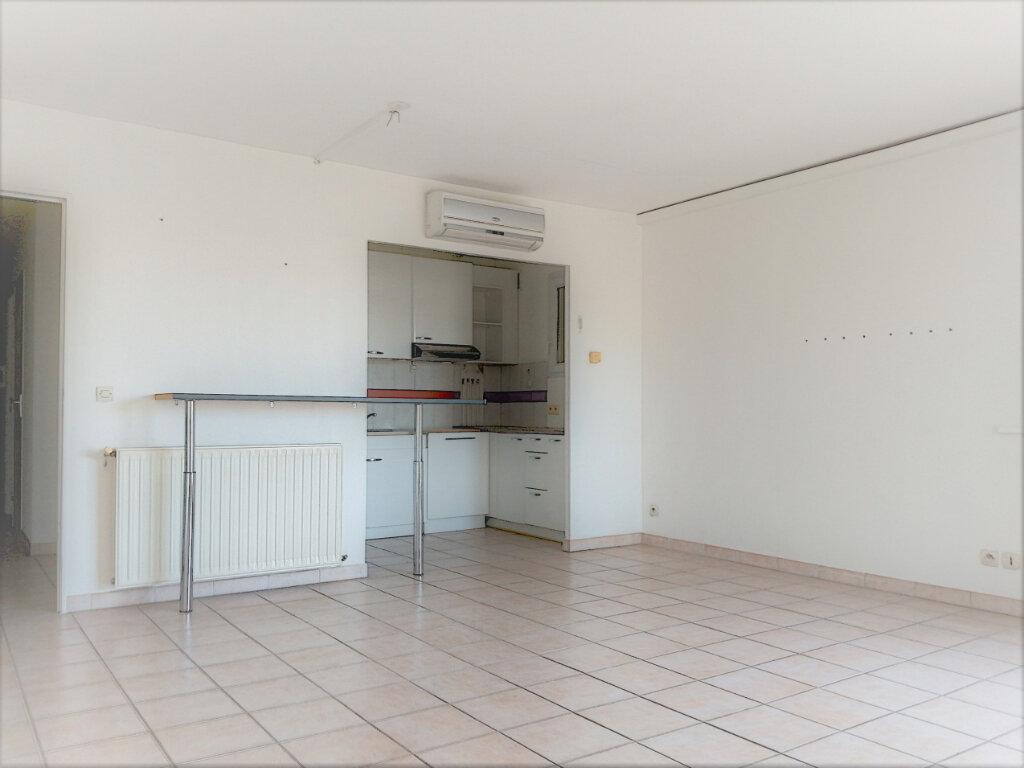Appartement à vendre 2 52m2 à Perpignan vignette-1