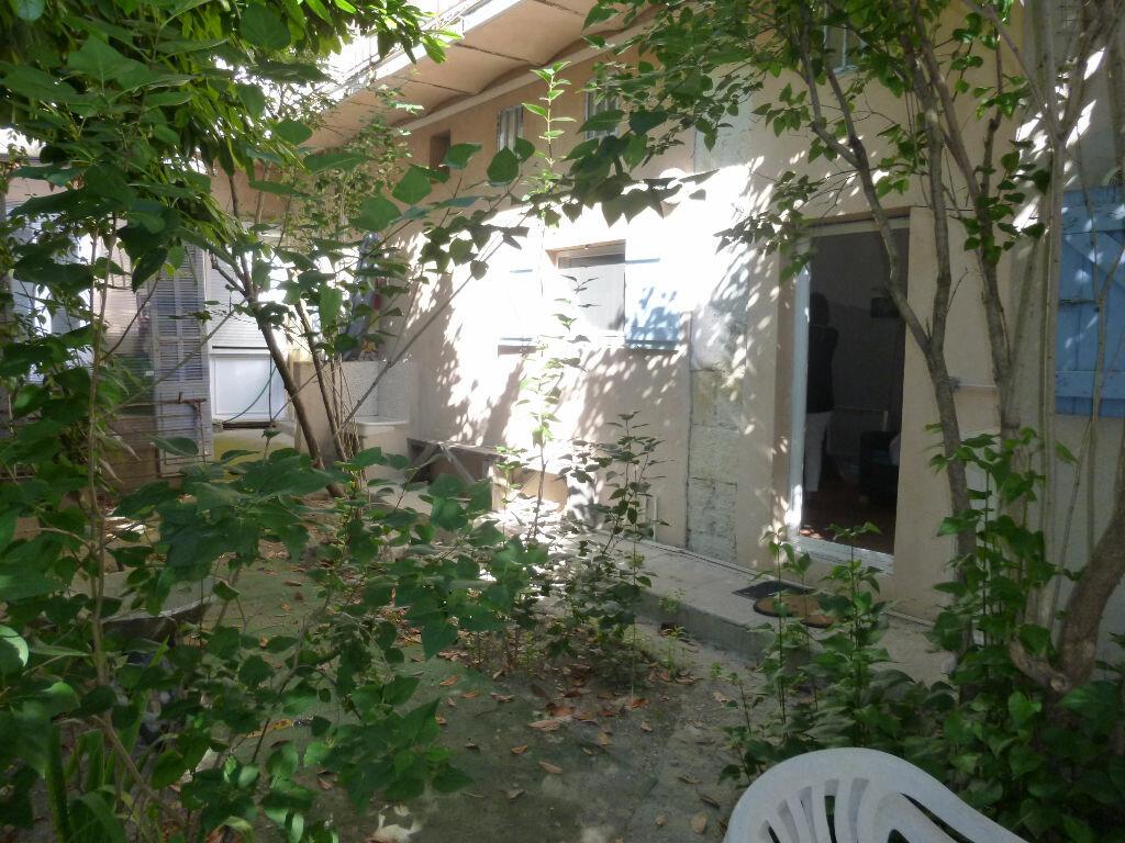 Appartement à louer 1 20m2 à Nîmes vignette-9