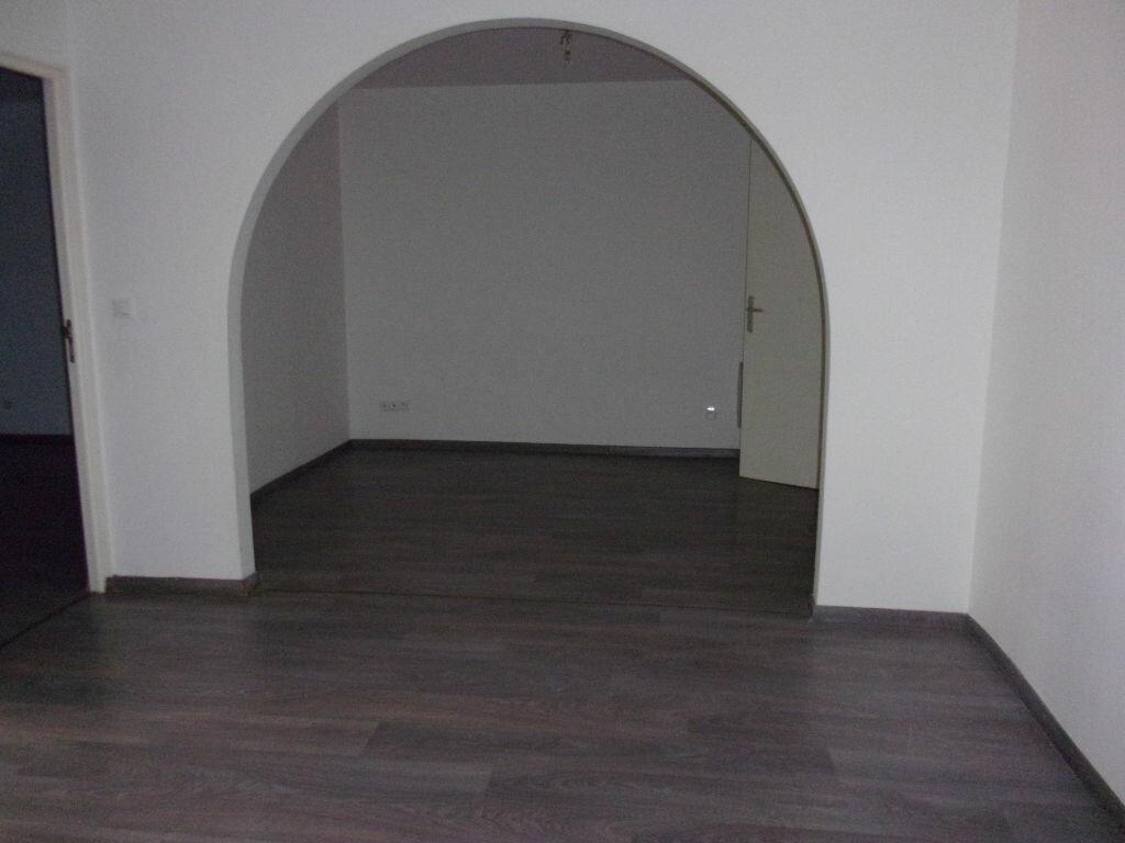 Appartement à louer 3 56.21m2 à Saint-Quentin vignette-1