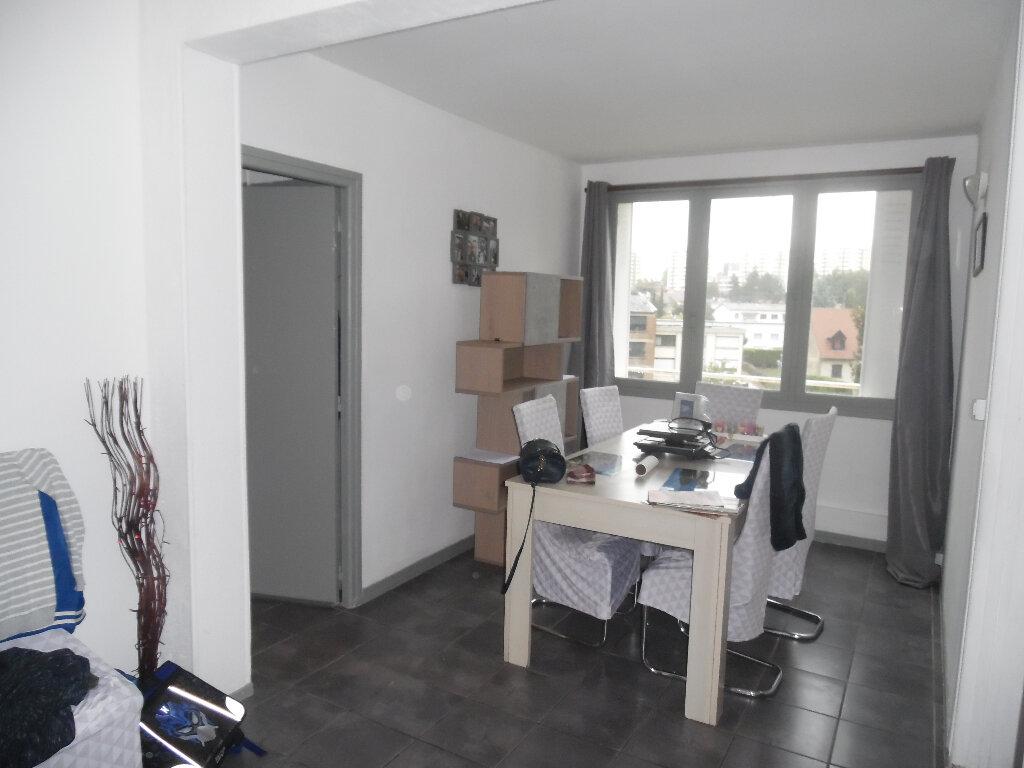 Appartement à vendre 4 66m2 à Saint-Quentin vignette-1