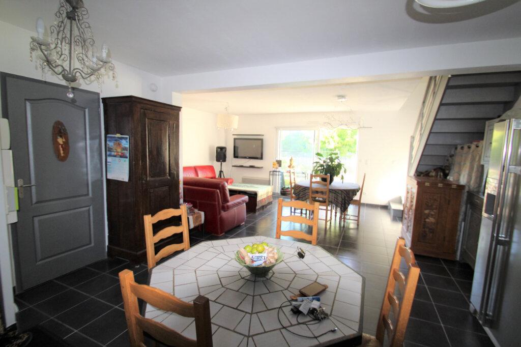 Maison à vendre 4 96.24m2 à Fleury-les-Aubrais vignette-5