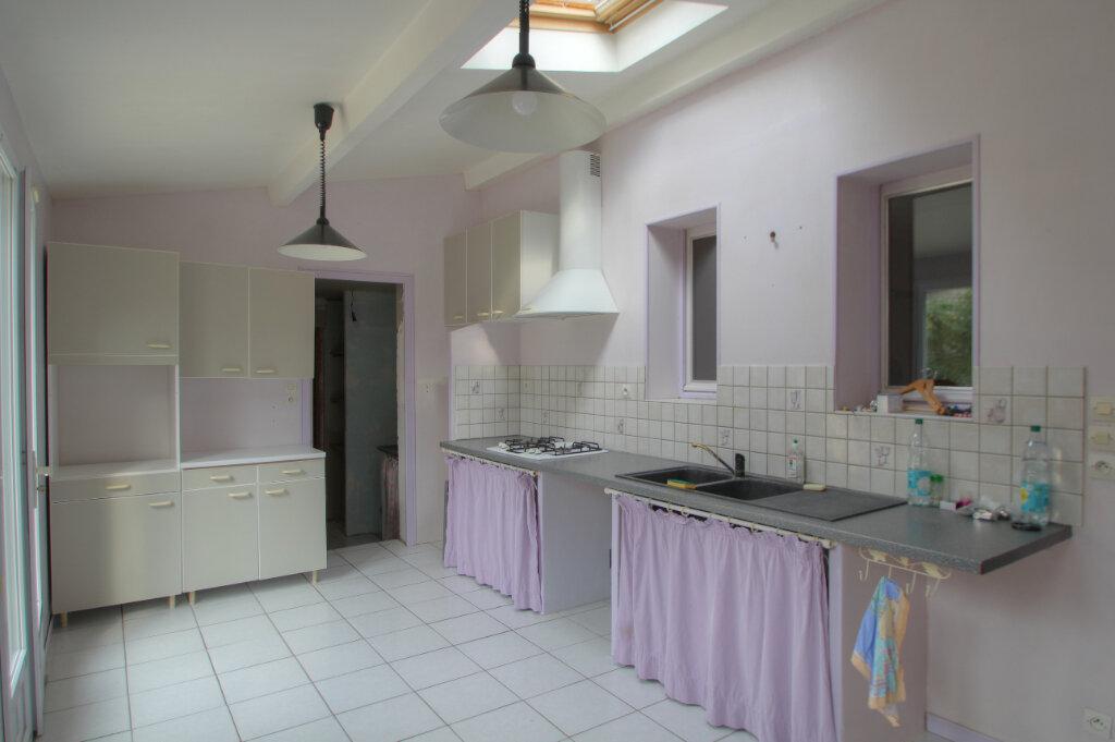 Maison à vendre 5 111m2 à Saint-Jean-de-la-Ruelle vignette-12