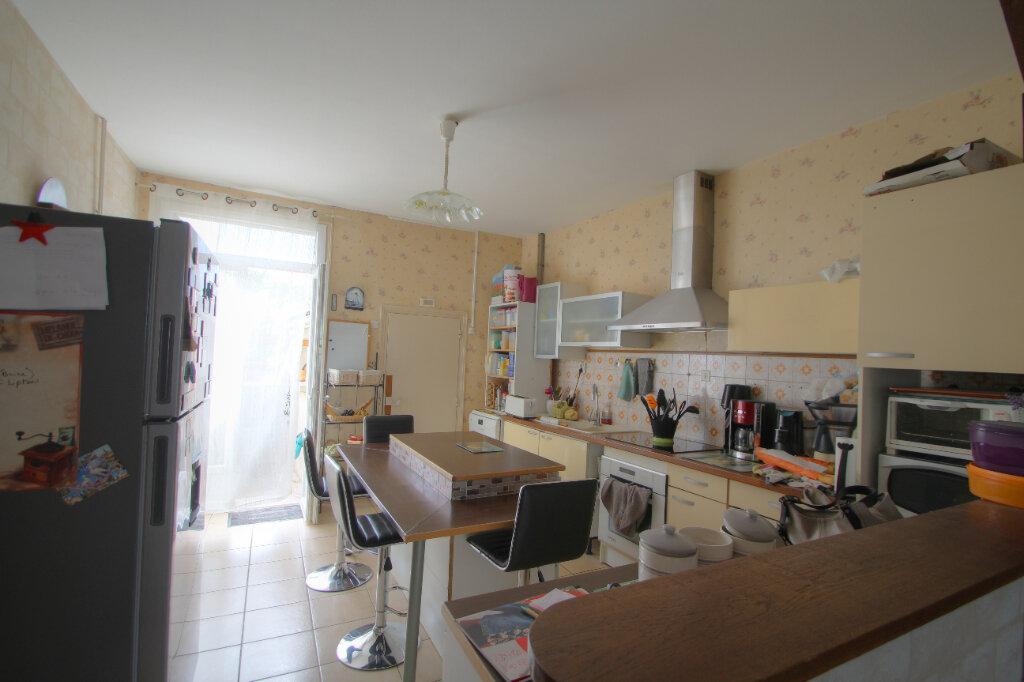 Maison à vendre 6 133m2 à Saint-Jean-de-la-Ruelle vignette-6