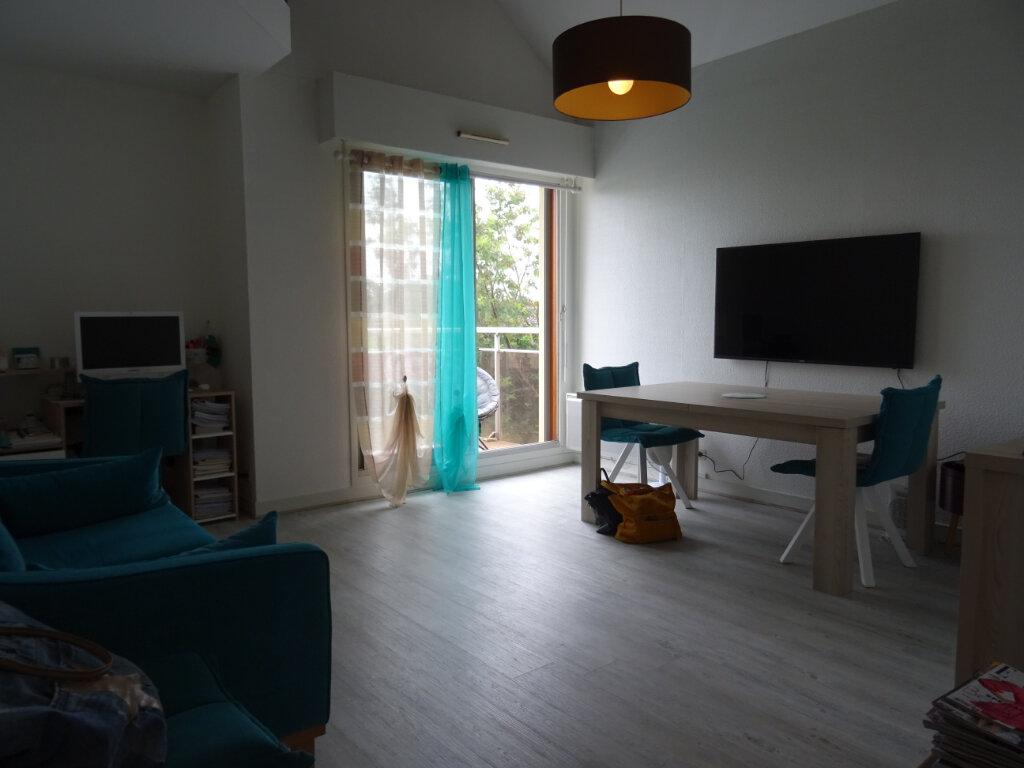 Appartement à vendre 3 69.79m2 à Limoges vignette-8