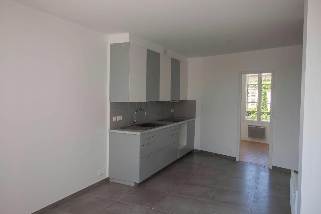Appartement à louer 3 40m2 à Magny-en-Vexin vignette-2