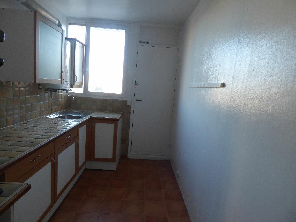 Appartement à vendre 3 54m2 à Fréjus vignette-1