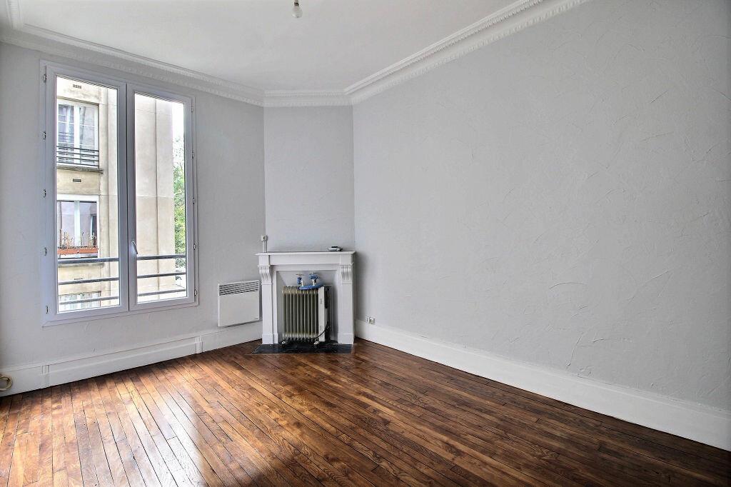 Appartement à louer 1 29.56m2 à Paris 14 vignette-2