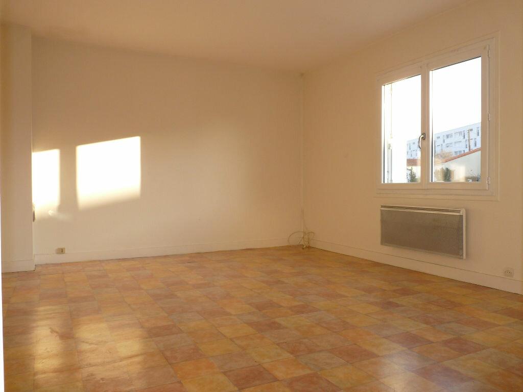 Appartement à vendre 4 70.63m2 à Royan vignette-5