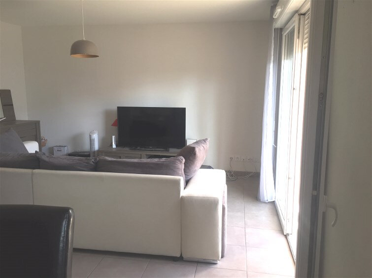 Appartement à vendre 3 65m2 à Poussan vignette-1