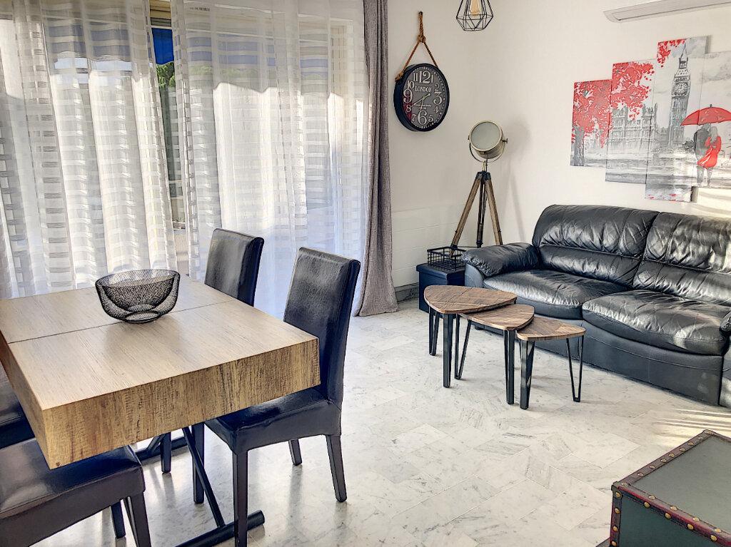 Appartement à louer 3 60.24m2 à Cagnes-sur-Mer vignette-3