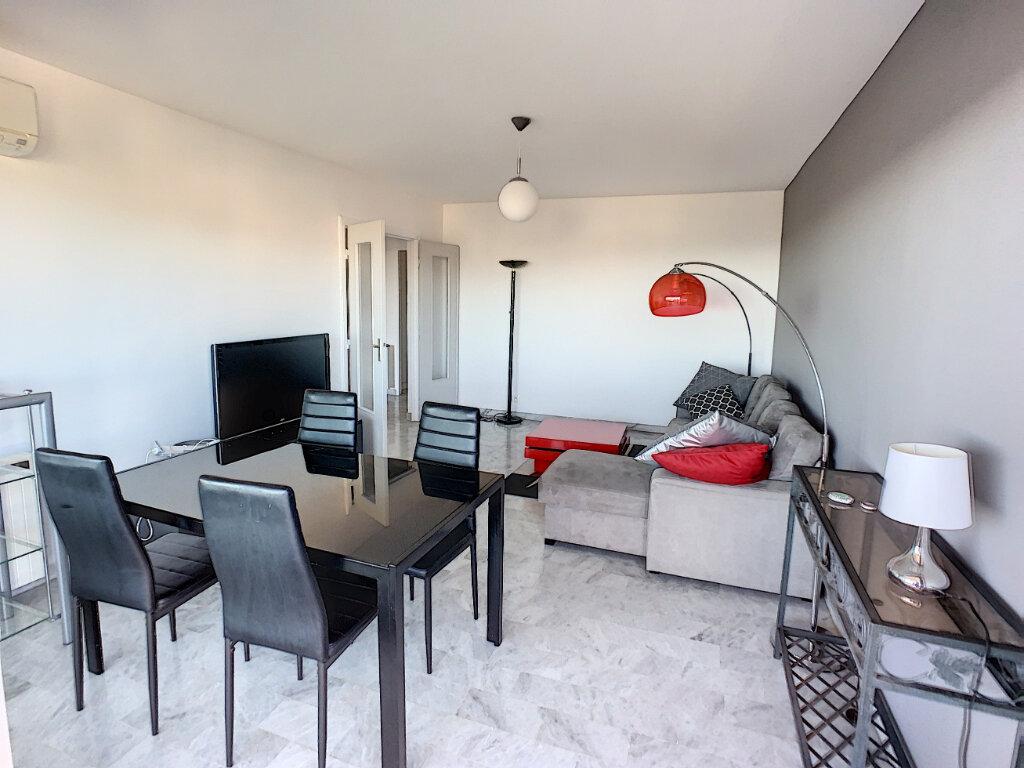 Appartement à louer 2 57m2 à Saint-Laurent-du-Var vignette-2