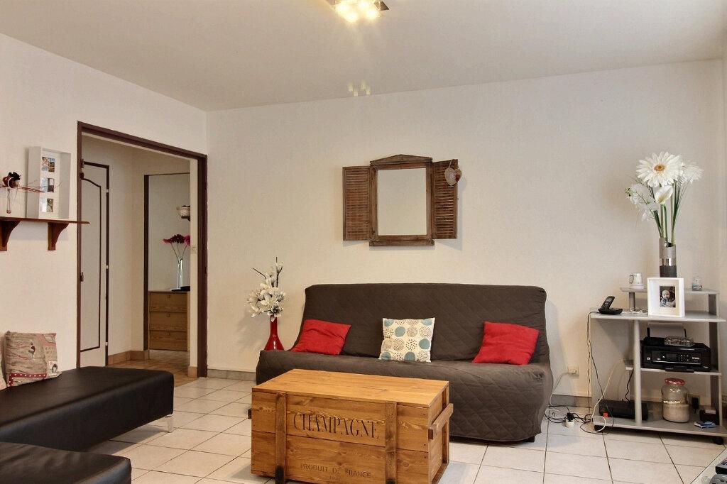 Appartement à vendre 3 64.97m2 à Roanne vignette-3